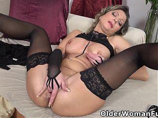 Hot mature Jane finger fucks her lubed pussy