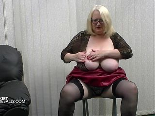 Lovely British busty mature masturbates in a PVC skirt